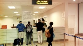 Customers are handling visa application to the Immigration officers (Noi Bai International Airport, Hanoi)